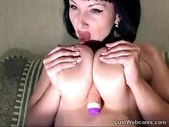 Busty brunette Milf masturbates with dildo on webcam