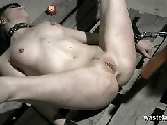 Brunette de renzy tapes slave chained to pallet on the dungeon floor and caned