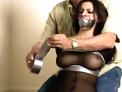 Kerri Taylor tapebound and tapegagged in 18 beatuful hd suit