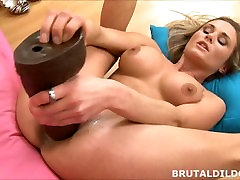 Busty blonde babe fucks a huge brown brutal dildo deep in her pussy in HD