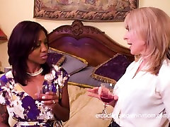 Mature blonde seduces a younger black chick for a lesbian fuck