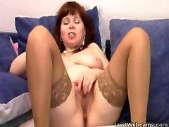 Big titted mature masturbates on webcam