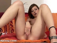 Lili pees all over herself and cums with a dildo