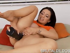 Brunette babe fucking her pussy with a massive black jerking slow motion dildo in HD