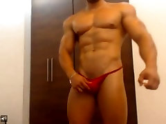 Latin muscle flexing and posing