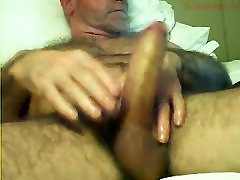 Hairy daddy playing with his huge cock