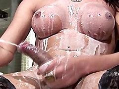 Tgirl soaks her bigtits in milk and shoots one big jizzload