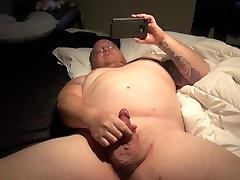 chubby tattooed guy with chestity boy dick jacks off to porn