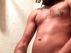 Dread-Head with a Latex Glove Jerks Off in Shower