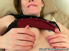 British milf Sexy P peels off her tights and plays with herself