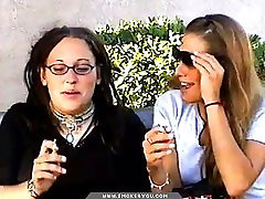 Mother and daughter smoking