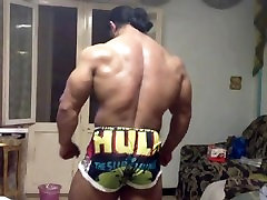 Bodybuilder poses at home