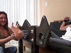 Daughter tickles moms feet