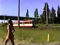 Hot woman nude walk around the railway