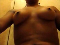 ebony bitch pissing and masturbing in her bathroom