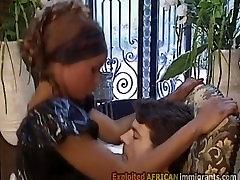 Beautiful African seachking lbeadadaking in latex sucks off her white master