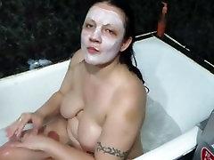 Mature jan adrienne brunette houston texas smokes in the bath with foam