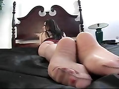 SEXY LEXI IN NYLONS ON BED foot tease