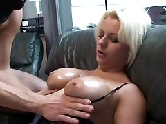 Blonde MILF blowjobing two guys
