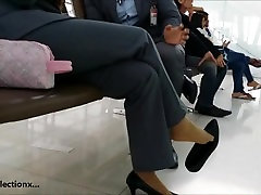 Asian airport stocking toe dangling