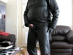 Wanking in black leather