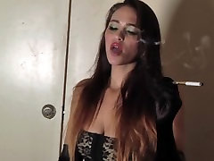 Sexy usa onlinegv in Black Stockings and Garters Blows Smoke from Sexy Mouth