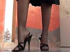 Gina in black high heel sandals