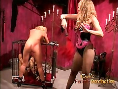 Stacked blonde bimbo gets spanked while a caged slut watches