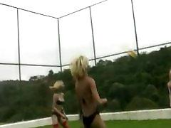 Four trannies in string bikini play volleybal