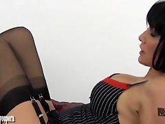 Sexy brunette Milf gives foot wank and handjob to nylon encased big cock