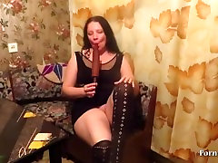 mature lady fucks her holes with a rolling pin