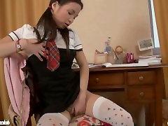 Schoolgirl doing homework masturbates with a dildo