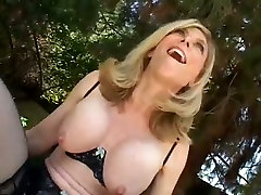 Mature blonde ahead of time in nylon stockings fucking dirty in a cowgirl pose