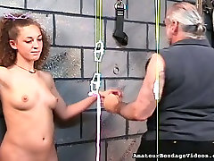 Hardy girls nipples are squeezes tight and strung in BDSM action