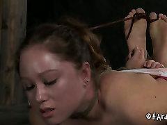 Wanton slave is hogtied on the wooden floor in hot brazzers kute scene