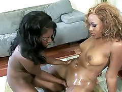 Two mature femdom bi ebony bimbos on the couch eating out each other