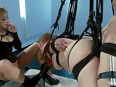 Suspended plump chick licks pussy that belongs to seductive mistress