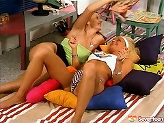 Alluring lesbians with slim bodies give pleasure to each other in 69 pose