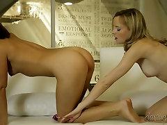 Two alluring lesbians enjoy position 69