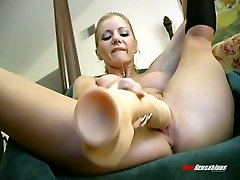Charming blonde bitch Amber Michaels masturbates with a gigantic closeup home porn toy