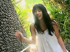 Gorgeous Asian babe Kaoru Goto takes shower in bikini