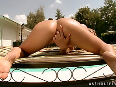 Sex-starved chick Aleksa is masturbating by the pool