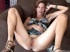 Gorgeous mature redhead fucks her pussy and asshole