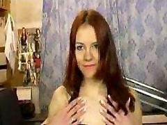 Caucasian redhead undressing