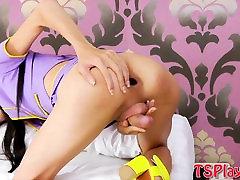 Very tight ladyboy masturbates her hard dick on the bed