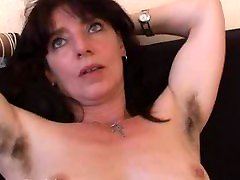 Hairy mature amateur in panties spreads her pussy