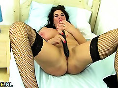 Huge titted cash cop toying in stockings