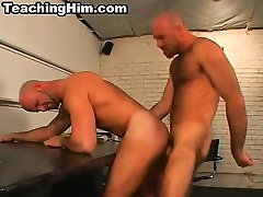 Mature hunk taking a hard cock into his tight ass