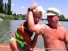 Hot Granny In Bikini Massages A Lonely Navigator