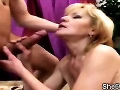 Nasty grandma enjoys a huge meatbone with her dry cunt